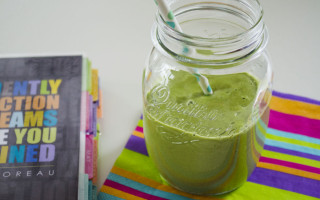 Green breakfast smoothie with sesame seeds